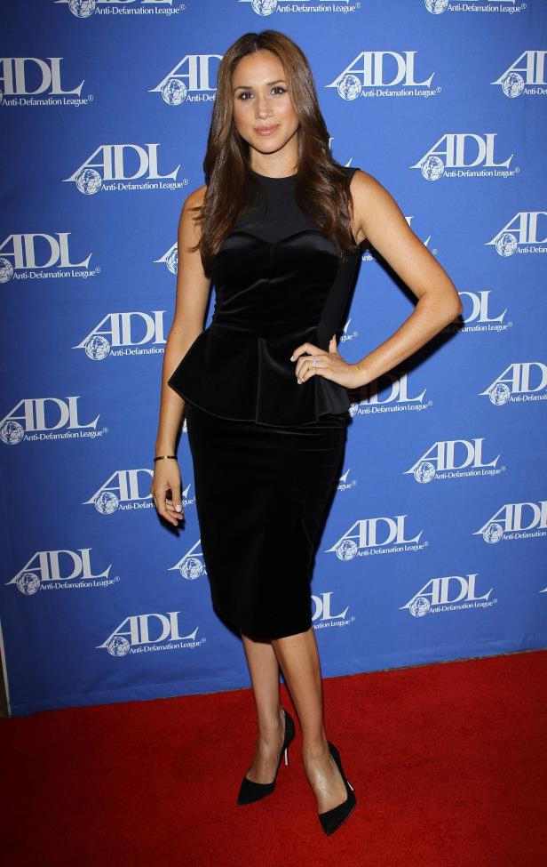 Meghan Markle in Stella McCartney sleeveless velvet peplum dress at Anti-Defamation League Entertainment Industry Awards Dinner Honoring Ryan Kavanaugh at The Beverly Hilton Hotel on October 11, 2011.