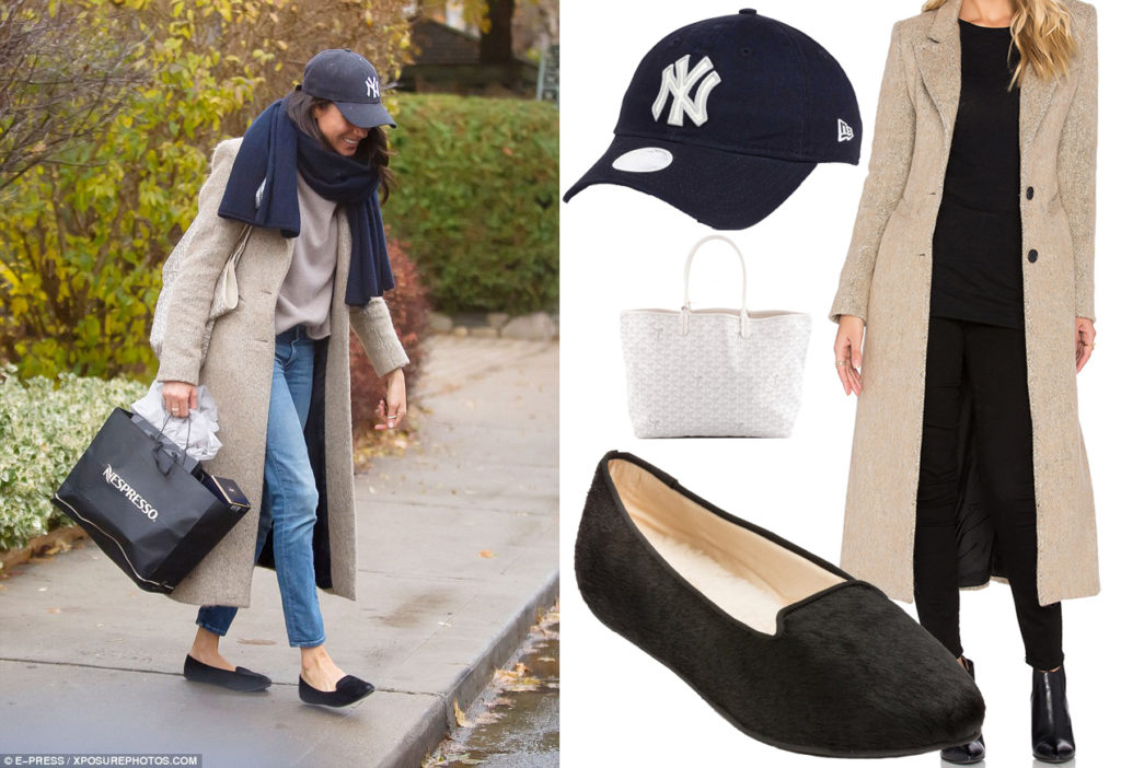Meghan Markle on the set of Suits in Toronto, Canada, wearing a Smythe Brando coat in Camel, Goyard tote and New Era New York Yankees Hat on November 19, 2016.