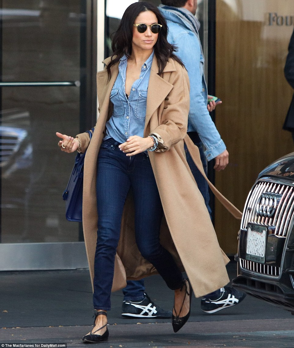Meghan Markle is seen on the streets of Toronto (November 4, 20160 in a Max Mara Manuela Camel Hair Wrap Coat, Saint Laurent Sac De Jour Bag in Royal Blue Leather and Sarah Flint Lily Flats.