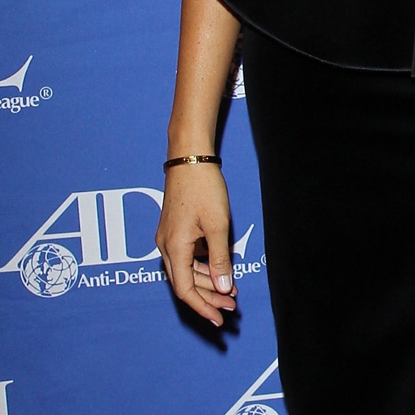 Meghan Markle wearing a Cartier 4K yellow gold love bracelet