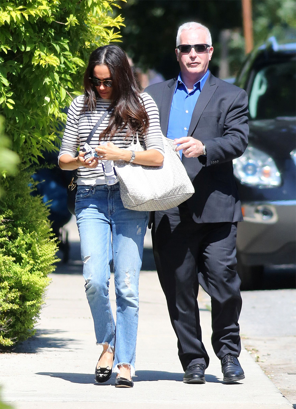 Meghan Markle arrives home surrounded by security in Toronto on July 6,  2017.