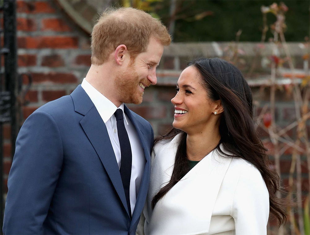 Prince Harry and Meghan Markle at their engagement photo call at Kensington Palace's 'Sunken Garden' on November 27, 2017.