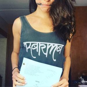 Meghan Markle wearing a Onzie 'Karma' Low Back Tank Top on Instagram.