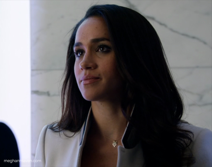 Meghan Markle wearing a Ginette NY Mini Gold Wolf Chain Necklace as Rachel Zane on Suits.