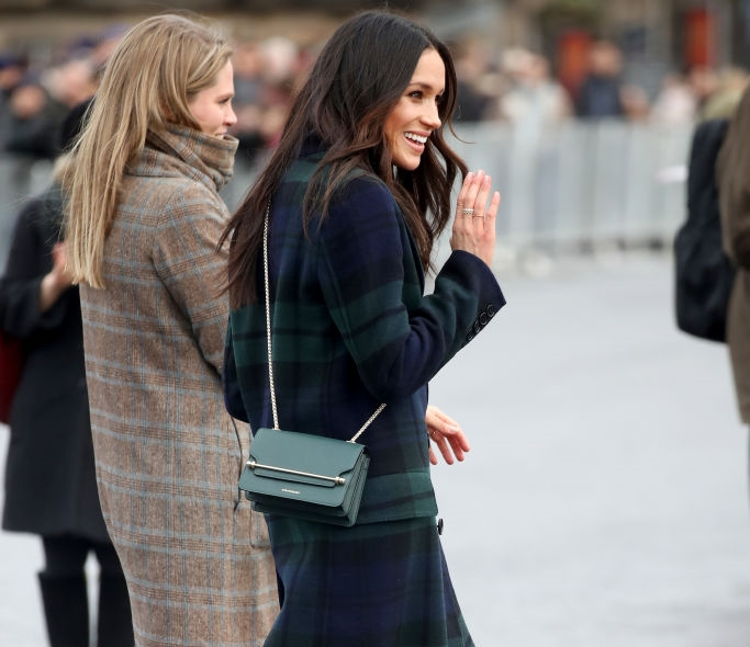 Meghan Markle wearing a Strathberry East/West Mini Bag in Bottle Green during visit to Edinburgh Castle in Scotland on February 13, 2018.