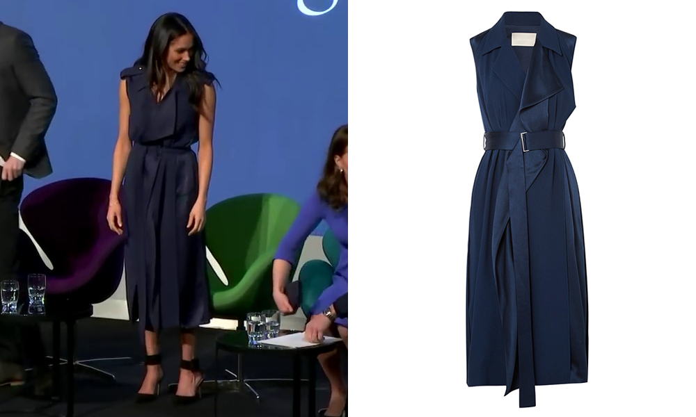 Meghan Markle wearing a Jason Wu Belted Satin Wrap Dress in Navy to the first annual Royal Foundation Forum held at Aviva on February 28, 2018 in London, England.