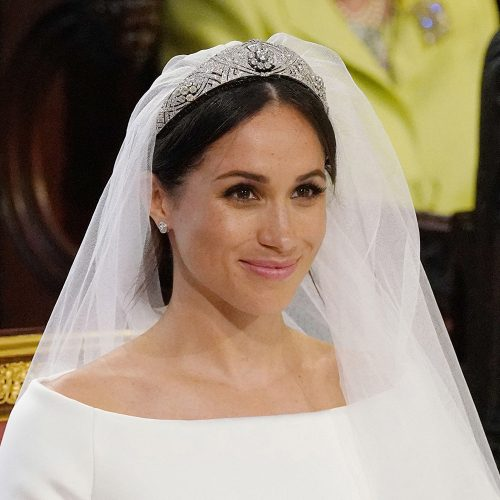 Meghan, Duchess of Sussex wearing the The Queen Mary diamond bandeau tiara for the Royal wedding on May 19, 2018.