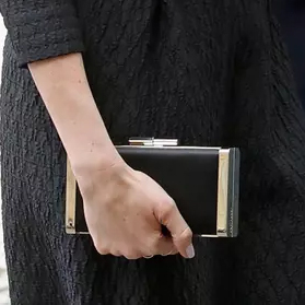 Clutch bag detail: Meghan Markle attends a Service of Thanksgiving and Commemoration at Westminster Abbey on ANZAC Day on April 25, 2018 in London, England.
