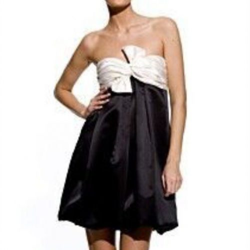 ABS Allen Schwartz Black and Ivory Bow Strapless Bubble Dress as seen on Meghan Markle in 2007.