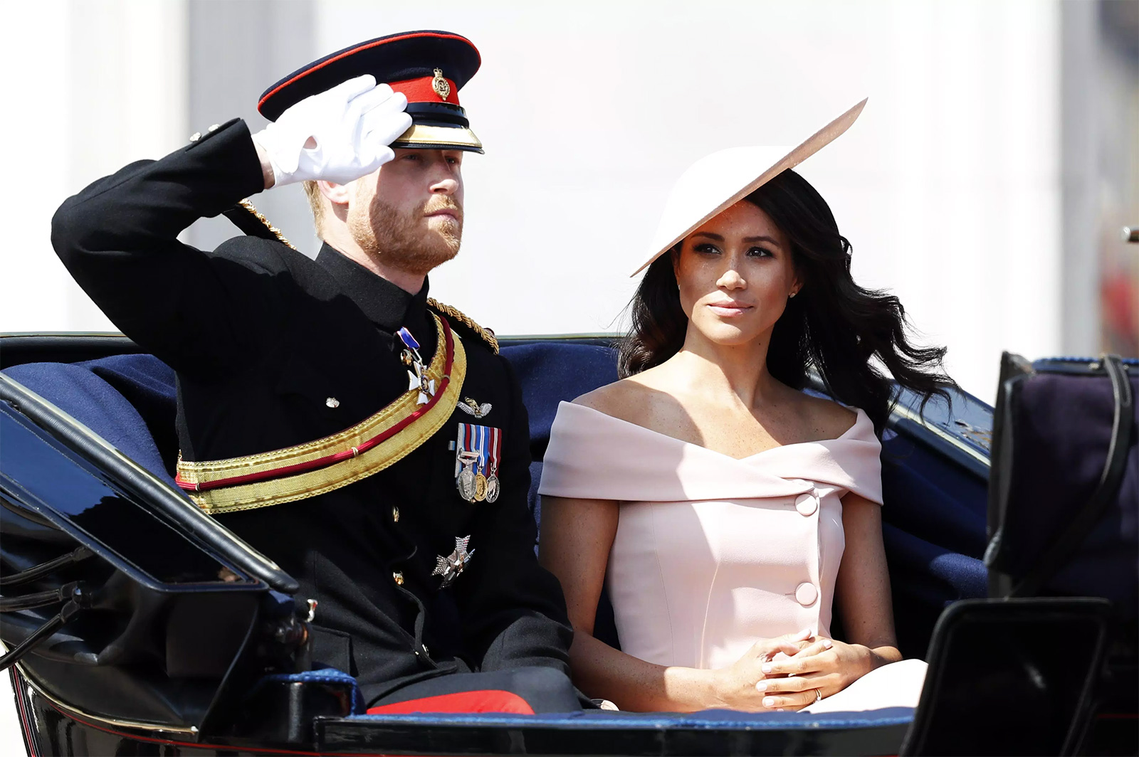 Prince Harry, Duke of Sussex and Meghan, Duchess of Sussex travel down The Mall in a horse drawn carriage during Trooping The Colour 2018 on June 9, 2018 in London, England.