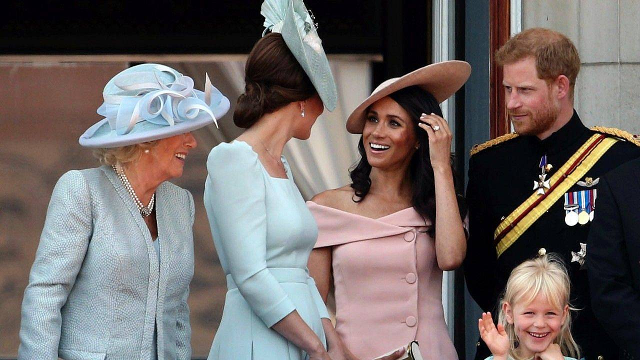 Meghan, Duchess of Sussex, Prince Harry, Duke of Sussex stand on the balcony of Buckingham Palace during Trooping The Colour 2018 on June 9, 2018 in London, England.
