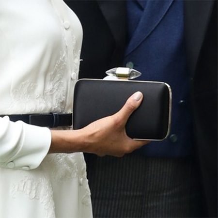 Clutch detail: Meghan, Duchess of Sussex attends day 1 of Royal Ascot at Ascot Racecourse on June 19, 2018 in Ascot, England.
