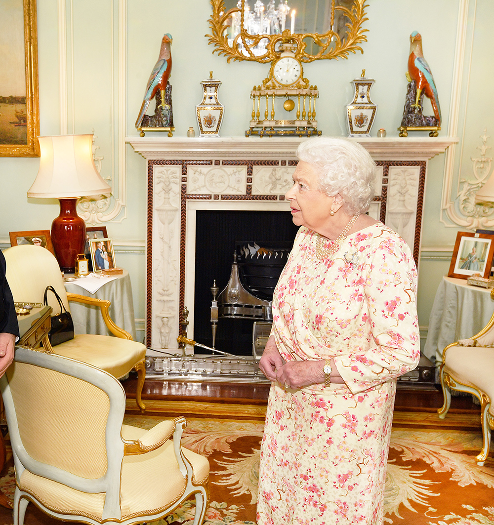 When the Queen greeted guests in her private audience room at Buckingham Palace on May 30, eagle-eyed watchers spotted a framed previously unseen photo of Meghan and Harry on the table in the background.