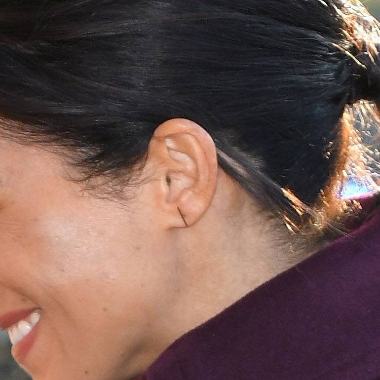 Earring detail: Meghan, Duchess of Sussex visiting the Hubb Community Kitchen at Al Manaar in North Kensington on November 21, 2018 in London, England.