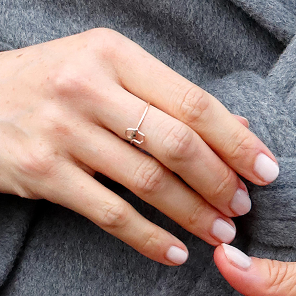 Ring detail: Meghan, Duchess of Sussex visits the Royal Variety Charity's Brinsworth House on December 18, 2018 in Twickenham, England.