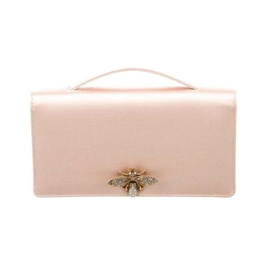 Dior D-Bee satin pochette clutch bag as seen on Meghan, Duchess of Sussex