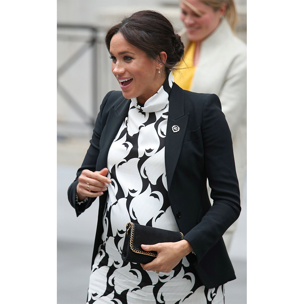 Meghan, Duchess of Sussex departs after joining a panel discussion convened by The Queen's Commonwealth Trust to mark International Women's Day at King's College London on March 08, 2019 in London, England.
