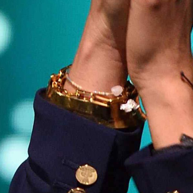 Bracelet detail - Meghan, Duchess of Sussex at We Day UK at SSE Arena on March 06, 2019 in London, England.